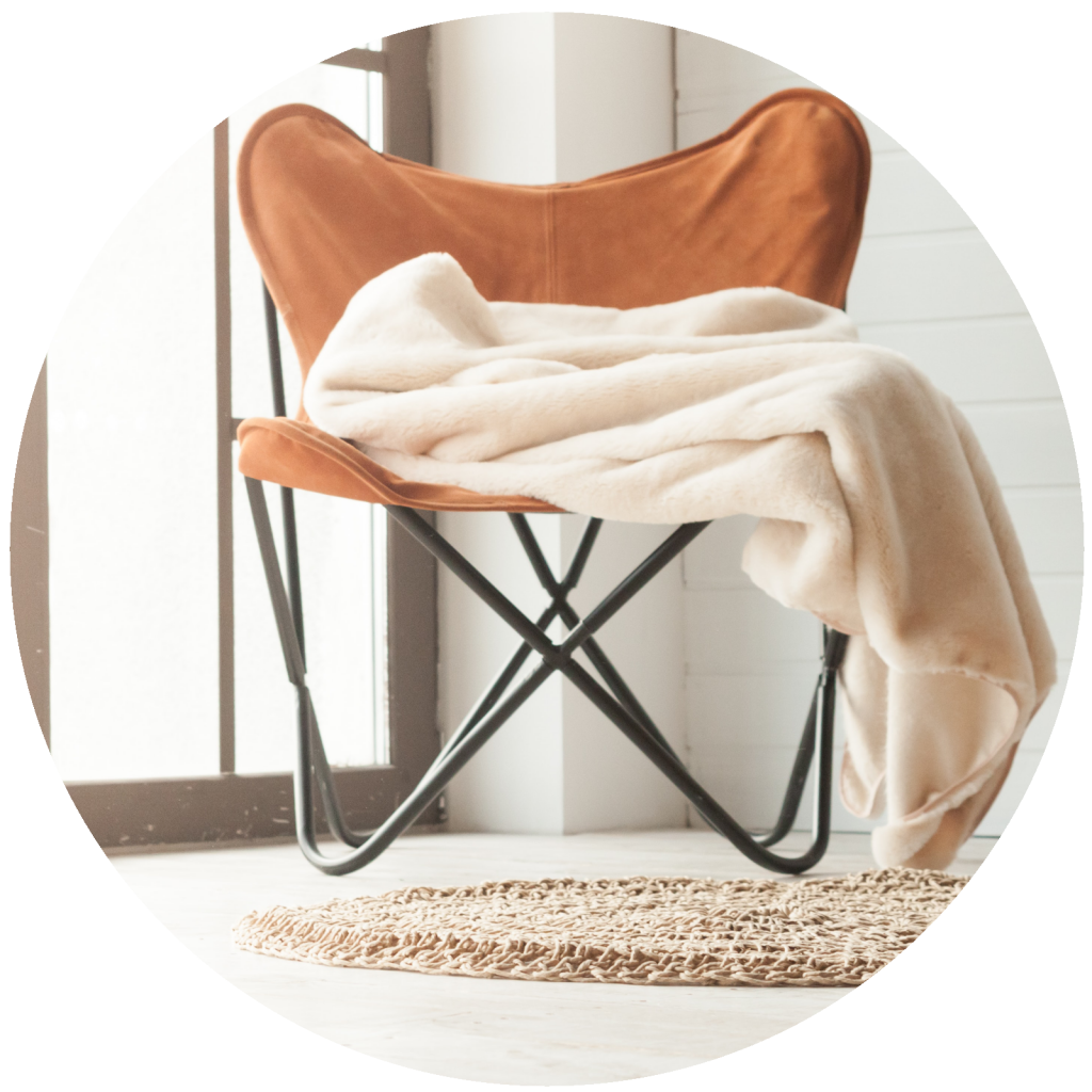 comfortable chair with blanket